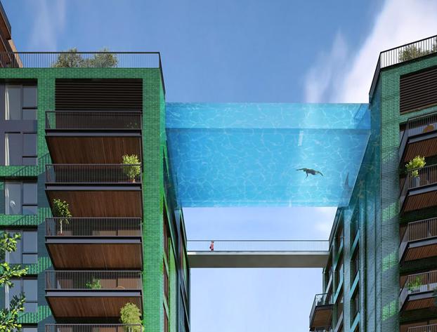 Dise an una piscina transparente que unir dos bloques de for Orgia en la piscina