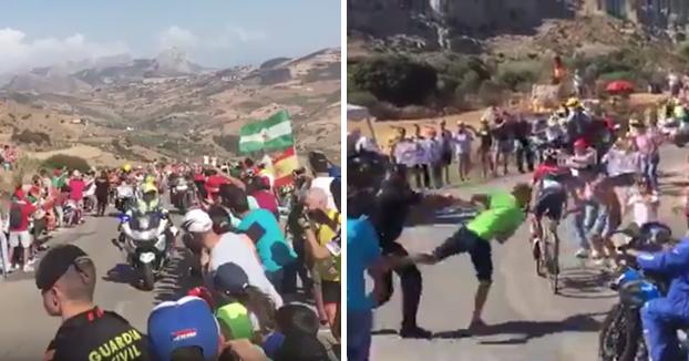 Un guardia civil empuja violentamente a un espectador de La Vuelta que corría al paso de los ciclistas (Vídeo)