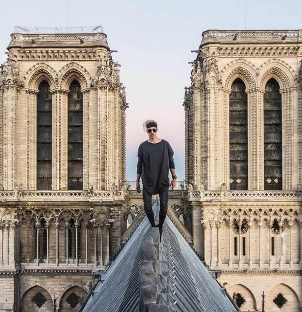 Simon Nogueira recorriendo el tejado y la aguja de Notre Dame de París en 2018