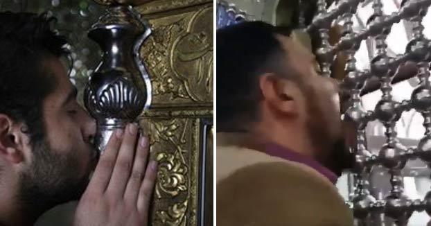 Iraníes besan y lamen santuarios para demostrar que no tienen miedo al Coronavirus