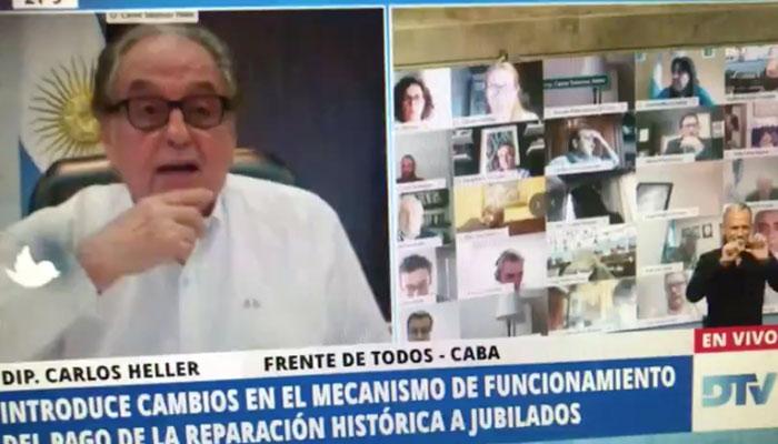 El diputado Juan Emilio Ameri besa los pechos de su pareja en plena sesión virtual del Congreso